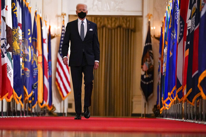 President Joe Biden arrives to speak about the COVID-19 pandemic during a prime-time address from the East Room of the White House, Thursday, March 11, 2021, in Washington. (AP Photo/Andrew Harnik)