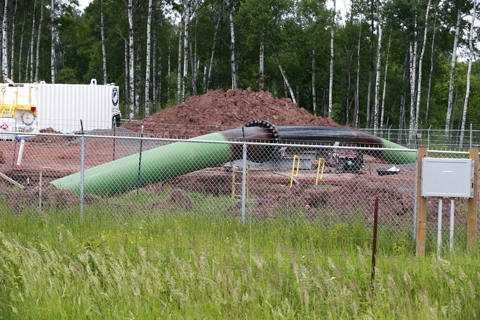 FILE - A Enbridge Energy pipeline drilling pad is shown in this June 29, 2018 file photo along a rail line that traces the Minnesota-Wisconsin border near Cloquet, Minn. Wednesday is the deadline for tribal and environmental groups opposed to Enbridge Energy's Line 3 oil pipeline project to ask the Minnesota Supreme Court to overturn a lower court decision affirming the approvals granted by independent regulators that allowed construction to begin last December. (AP Photo/Jim Mone, file)