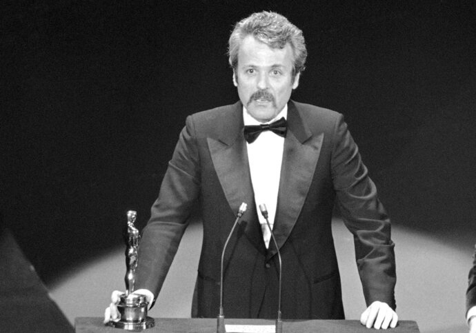 FILE - In this March 28, 1977 file photo, William Goldman accepts his Oscar at Academy Awards in Los Angeles, for screenplay from other medium for
