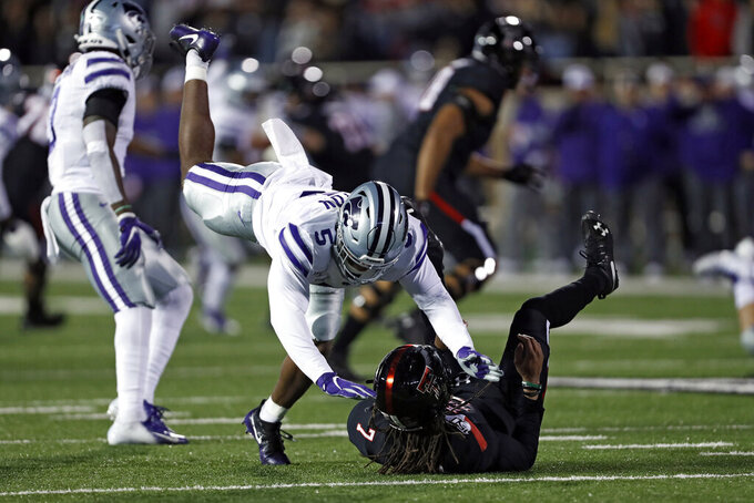 Kansas State's Da'Quan Patton (5) knocks down Texas Tech's Jett Duffey (7) after Duffey threw the ball during the first half of an NCAA college football game Saturday, Nov. 23, 2019, in Lubbock, Texas. (Brad Tollefson/Lubbock Avalanche-Journal via AP)