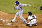 New York Mets' Dominic Smith (2) follows through on a double to score Michael Conforto as Miami Marlins catcher Francisco Cervelli (29) looks on during the eighth inning of a baseball game, Wednesday, Aug. 19, 2020, in Miami. (AP Photo/Lynne Sladky)