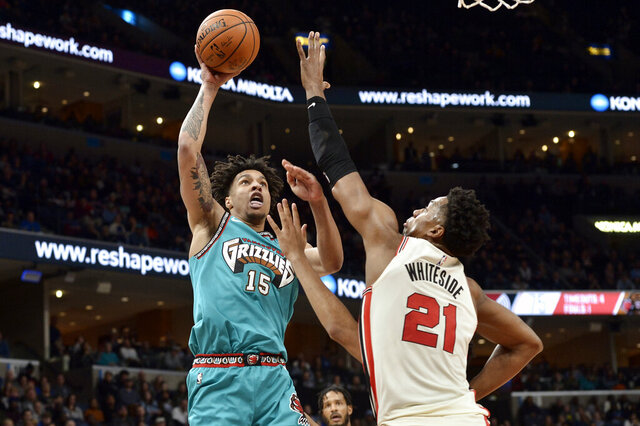 Memphis Grizzlies forward Brandon Clarke (15) shoots against Portland Trail Blazers center Hassan Whiteside (21) during the second half of an NBA basketball game Wednesday, Feb. 12, 2020, in Memphis, Tenn. (AP Photo/Brandon Dill)