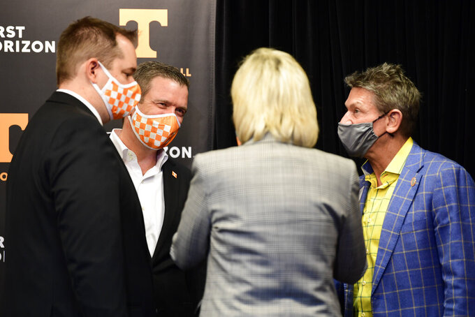 From left, new University of Tennessee NCAA college football head coach Josh Heupel, Tennessee athletic director Danny White, school chancellor Donde Plowman, and president of the UT System Randy Boyd, speak after an introductory press conference at Neyland Stadium in Knoxville, Tenn., Wednesday, Jan. 27, 2021. (Caitie McLekin/Knoxville News Sentinel via AP, Pool)