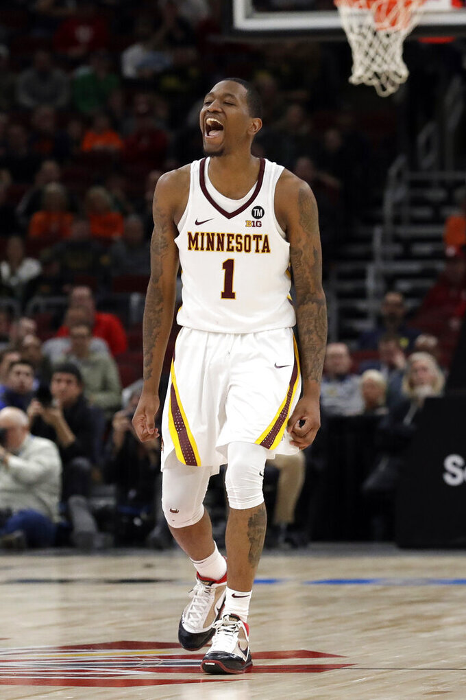 Minnesota's Dupree McBrayer (1) reacts during the overtime of an NCAA college basketball game against the Penn State in the second round of the Big Ten Conference tournament, Thursday, March 14, 2019, in Chicago. Minnesota won 77-72 in overtime. (AP Photo/Nam Y. Huh)