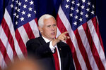 Vice President Mike Pence points to a guest after participatig in a Libre Initiative Roundtable at Grand Canyon University, Friday, Sept. 18, 2020, in Phoenix. (AP Photo/Matt York)
