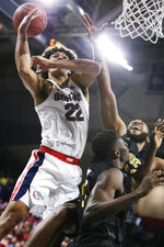 Gonzaga forward Anton Watson, left, and Alabama State forward Mike Stone, right, go after a rebound during the second half of an NCAA college basketball game in Spokane, Wash., Tuesday, Nov. 5, 2019. Gonzaga won 95-64. (AP Photo/Young Kwak)