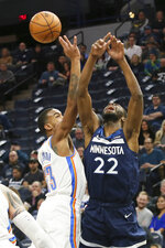 Oklahoma City Thunder's Terrance Ferguson, left, knocks the ball away from Minnesota Timberwolves' Andrew Wiggins in the first half of an NBA basketball game Monday, Jan. 13, 2020, in Minneapolis. (AP Photo/Jim Mone)