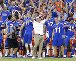"FILE - In this Oct. 6, 2018, file photo, Florida head coach Dan Mullen, center, celebrates with players on the sidelines during the final moments of an NCAA college football game against LSU, in Gainesville, Fla. Florida (6-2, 4-2 Southeastern Conference) begins a three-game homestand Saturday against Missouri (4-4, 0-4). The Gators also host South Carolina and Idaho over the first three weekends of November. The late-season stretch will go a long way toward determining which bowl game Mullen's team lands. It also will establish how many ""stadiums"" players will have to run after the season.(AP Photo/John Raoux, File)"