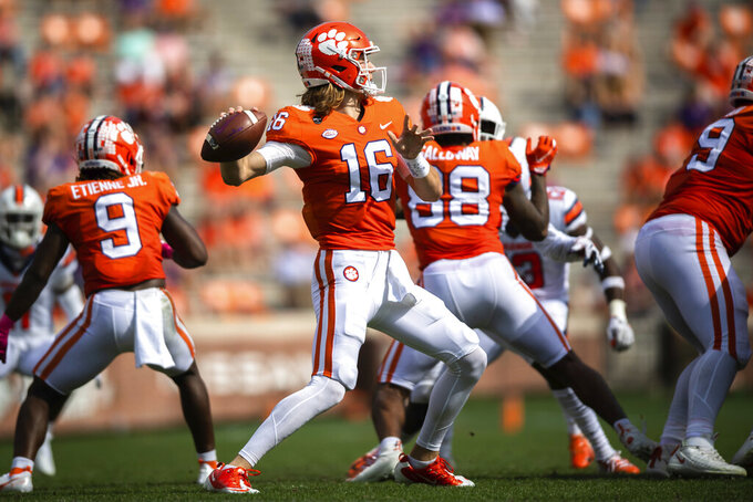 Clemson quarterback Trevor Lawrence (16) throws a pass during an NCAA college football game against Syracuse in Clemson, S.C., on Saturday, Oct. 24, 2020. (Ken Ruinard/Pool Photo via AP)