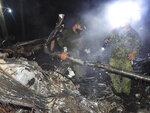 In this photo released by the Joint Task Force - Sulu, military soldiers work near the remains of a Philippine military C-130 plane that crashed in Patikul town, Sulu province, southern Philippines on Sunday July 4, 2021. The Lockheed C-130 Hercules, which was carrying 96 mostly combat troops, overshot the runway while landing Sunday at the Jolo airport. (Joint Task Force-Sulu via AP)