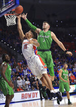 Florida forward Keyontae Johnson (11) shoots past Marshall forward Jannson Williams (3) during the first half of an NCAA college basketball game Friday, Nov. 29, 2019, in Gainesville, Fla. (AP Photo/Matt Stamey)