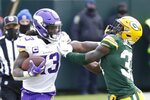 Minnesota Vikings' Dalvin Cook tries to get padt Green Bay Packers' Josh Jackson during the second half of an NFL football game Sunday, Nov. 1, 2020, in Green Bay, Wis. (AP Photo/Mike Roemer)