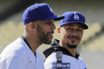 New Los Angeles Dodgers players David Price, left, and Mookie Betts speak during a news conference to announce their acquisition at the Dodger Stadium in Los Angeles, Wednesday, Feb. 12, 2020. (AP Photo/Chris Carlson)