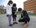 """We saw her on TV this morning, then seeing her today was really cool,"" said Carter Thompson, 7, as she and her sister Avary Thompson, 6, center, get signatures from St. Louis mayoral candidate Cara Spencer outside the Nance Elementary School voting location in St. Louis, Tuesday, April 6, 2021. Spencer is running against Tishaura Jones for the mayoral seat. (Colter Peterson/St. Louis Post-Dispatch via AP)"