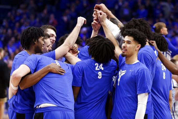 Kentucky players huddle before an NCAA college basketball game against Vanderbilt wearing warm-up shirts honoring Kobe Bryant in Lexington, Ky., Wednesday, Jan 29, 2020. (AP Photo/James Crisp)
