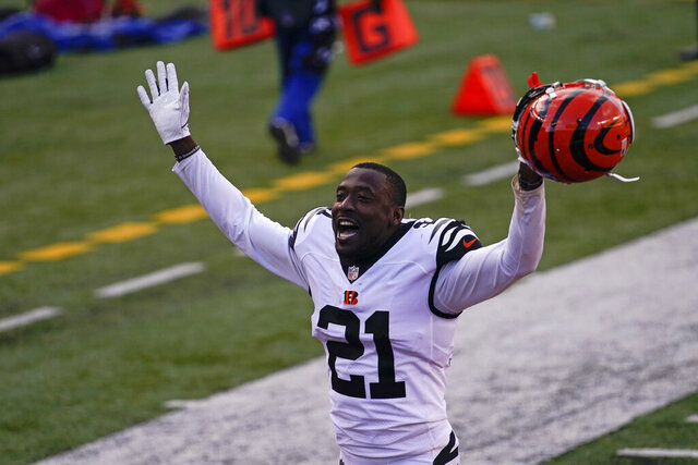 Cincinnati Bengals' Mackensie Alexander (21) celebrates as he leaves the field following of an NFL football game against the Tennessee Titans, Sunday, Nov. 1, 2020, in Cincinnati. Cincinnati won 31-20. (AP Photo/Bryan Woolston)