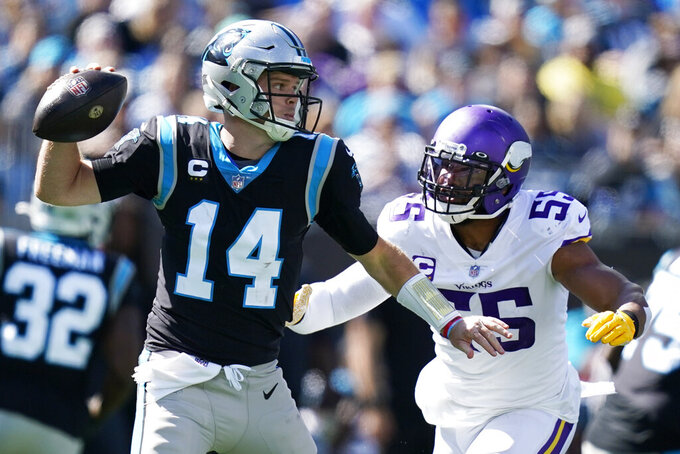 Minnesota Vikings outside linebacker Anthony Barr (55) pressures Carolina Panthers quarterback Sam Darnold (14) during the first half of an NFL football game, Sunday, Oct. 17, 2021, in Charlotte, N.C. (AP Photo/Gerald Herbert)