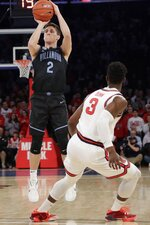 Villanova's Collin Gillespie (2) shoots over St. John's Rasheem Dunn (3) during the first half of an NCAA college basketball game Tuesday, Jan. 28, 2020, in New York. (AP Photo/Frank Franklin II)