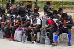 Haitian migrants prepare to board boats in Necocli, Colombia, Monday, Sept. 13, 2021. Migrants have been gathering in Necocli as they move north to Acandi, near Colombia's border with Panama, on their journey to the U.S. border. (AP Photo/Fernando Vergara)