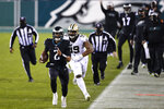 Philadelphia Eagles' Jalen Hurts scrambles during the first half of an NFL football game against the New Orleans Saints, Sunday, Dec. 13, 2020, in Philadelphia. (AP Photo/Derik Hamilton)