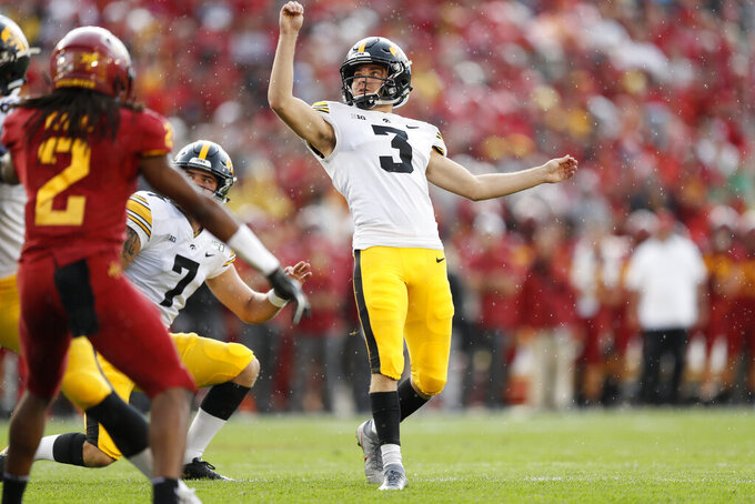 FILE - In this Sept. 14, 2019, file photo, Iowa kicker Keith Duncan (3) kicks a field goal during the first half of an NCAA college football game against Iowa State, in Ames, Iowa. Duncan was a freshman hero _ only to lose his job for two full seasons. He's re-emerged as a key cog for the 14th-ranked Hawkeyes in 2019. (AP Photo/Charlie Neibergall, File)