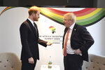 Britain's Prince Harry and Prime Minister Boris Johnson, right, at the UK Africa Investment Summit in London, Monday Jan. 20, 2020. Boris Johnson is hosting 54 African heads of state or government in London. The move comes as the U.K. prepares for post-Brexit dealings with the world. (Stefan Rousseau/Pool via AP)