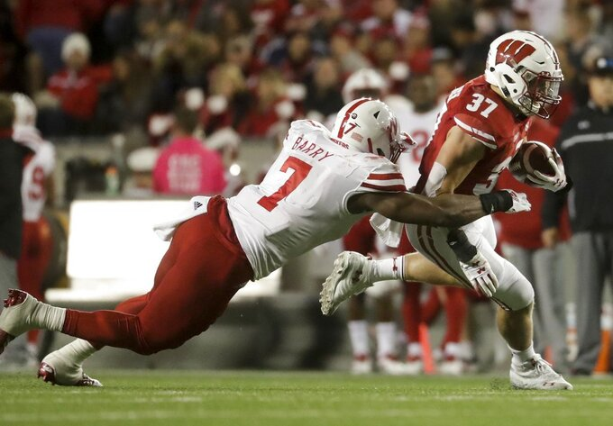 Wisconsin's Garrett Groshek runs past Nebraska's Mohamed Barry during the first half of an NCAA college football game Saturday, Oct. 6, 2018, in Madison, Wis. (AP Photo/Morry Gash)