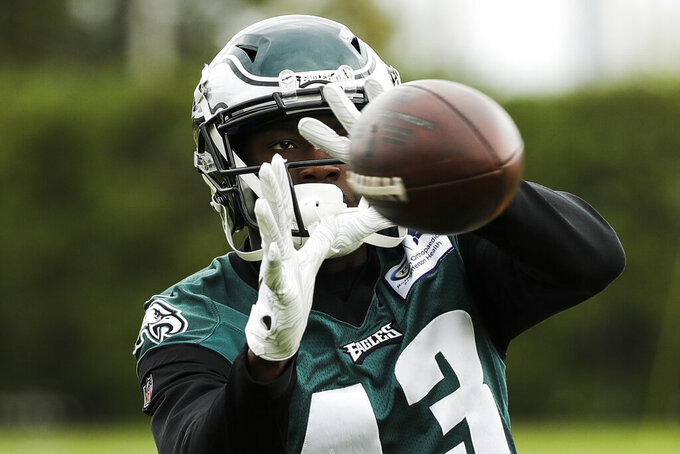 Philadelphia Eagles' Nelson Agholor catches a pass at the NFL football team's training facility in Philadelphia, Thursday, Oct. 17, 2019. (AP Photo/Matt Rourke)
