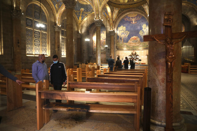 A burned pew is seen at the Church of All Nations in the Garden of Gethsemane, in east Jerusalem, Friday, Dec. 4, 2020. Israeli police said Friday they arrested a Jewish man after he poured out a