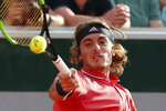 FILE - In this May 30, 2018, file photo, Greece's Stefanos Tsitsipas returns the ball to Austria's Dominic Thiem during their second round match of the French Open tennis tournament at the Roland Garros stadium in Paris. (AP Photo/Thibault Camus, File)