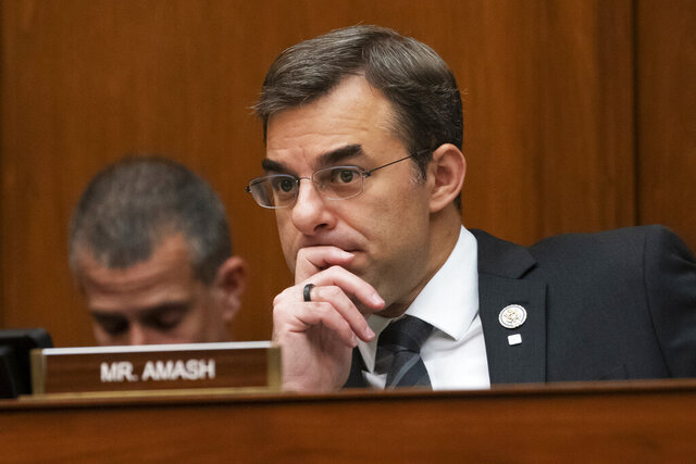 FILE - In this June 12, 2019, file photo, Rep. Justin Amash, R-Mich., listens to debate on Capitol Hill in Washington. The first major third-party candidate is emerging in the contest between President Donald Trump and presumptive Democratic nominee Joe Biden. Amash wants to seek the White House as a Libertarian after switching from Republican to independent last July 4 and voting in favor of Trump's impeachment. (AP Photo/J. Scott Applewhite, File)