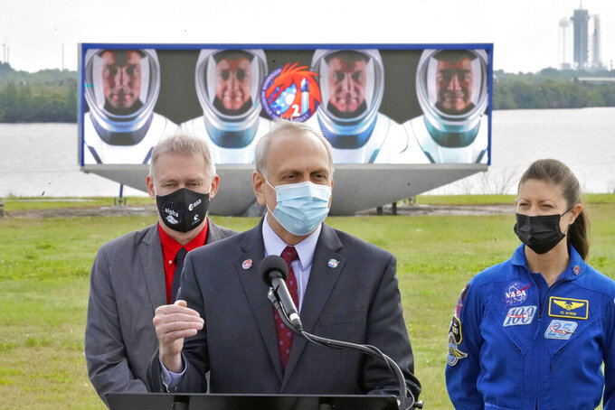 Acting NASA administrator Steve Jurczyk speaks to the media as he stands with Frank De Winne, left, of the European Space Agency, and NASA astronaut Tracy Caldwell Dyson during a news conference Wednesday, April 21, 2021, at the Kennedy Space Center in Cape Canaveral, Fla. Four astronauts will fly on the SpaceX Crew-2 mission to the International Space Station scheduled for launch on April 23. (AP Photo/Chris O'Meara)