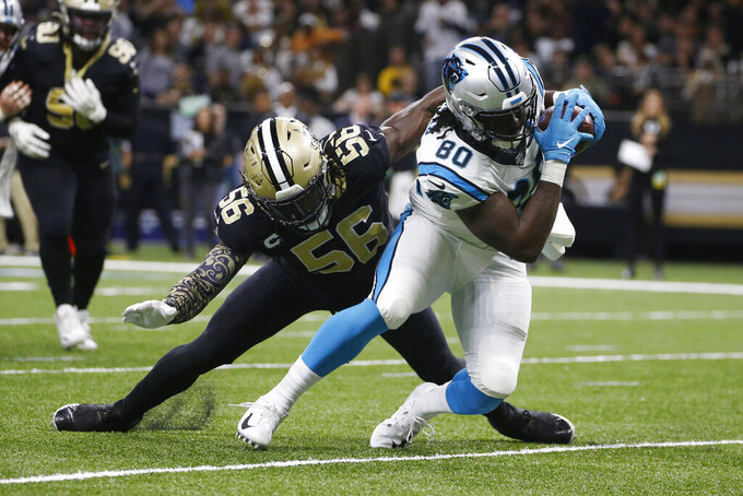 New Orleans Saints outside linebacker Demario Davis (56) attempts to tackle Carolina Panthers tight end Ian Thomas (80), during the second half at an NFL football game, Sunday, Nov. 24, 2019, in New Orleans. (AP Photo/Butch Dill)