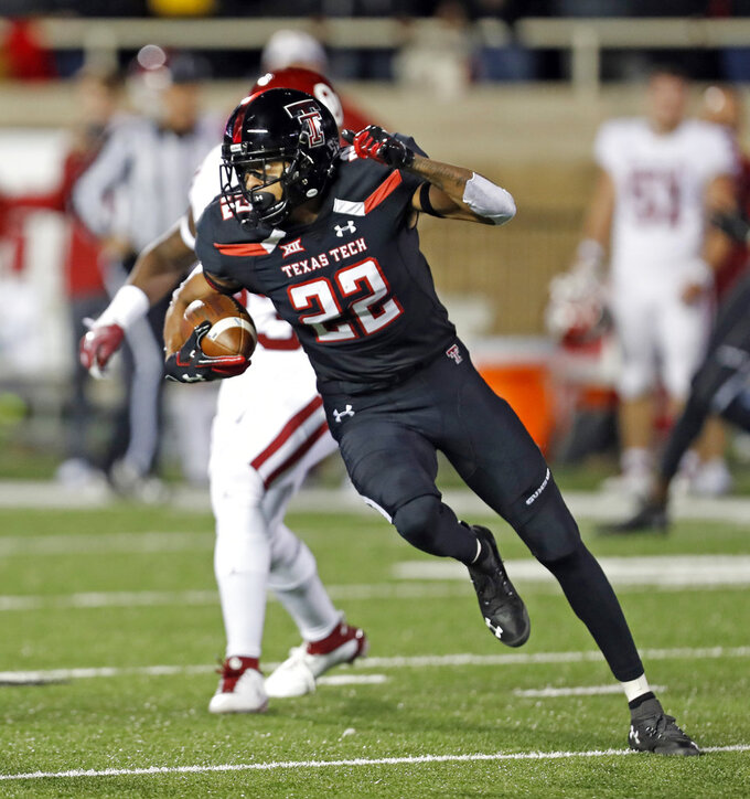 Texas Tech's Seth Collins (22) runs down field with the ball during the first half of an NCAA college football game against Oklahoma, Saturday, Nov. 3, 2018, in Lubbock, Texas. (AP Photo/Brad Tollefson)