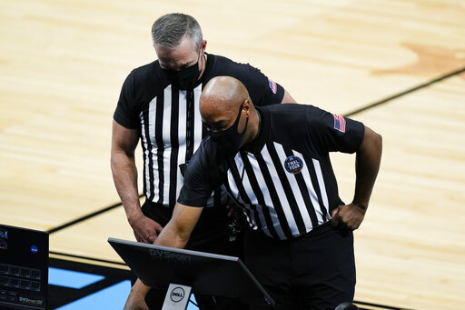 Officials review a play during the second half of a men's Final Four NCAA college basketball tournament semifinal game between Gonzaga and UCLA, Saturday, April 3, 2021, at Lucas Oil Stadium in Indianapolis. (AP Photo/Darron Cummings)