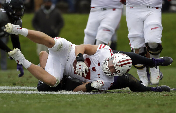 Wisconsin running back Garrett Groshek (37) is tackled by Northwestern linebacker Paddy Fisher during the second half of an NCAA college football game in Evanston, Ill., Saturday, Oct. 27, 2018. (AP Photo/Nam Y. Huh)