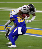Free safety Nasir Adderley, left, of the Los Angeles Chargers tackles wide receiver Russell Gage, right, of the Atlanta Falcons in the fourth quarter of an NFL football game in Inglewood on Sunday, Dec. 13, 2020. (Keith Birmingham/The Orange County Register via AP)