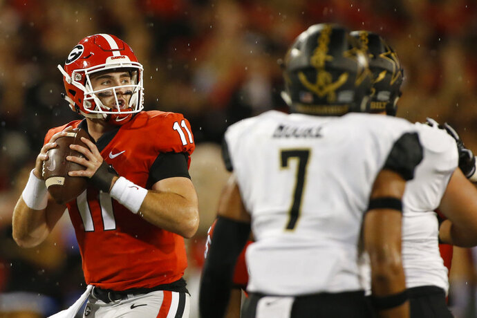 Georgia quarterback Jake Fromm (11) looks to throw the ball during an NCAA college football game against Vanderbilt on Saturday, Oct. 6, 2018, in Athens, Ga. (Joshua L. Jones/Athens Banner-Herald via AP)