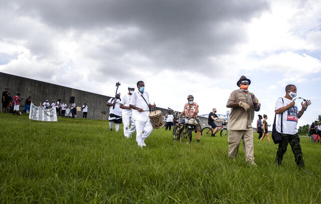 A march and secondline starts on the levee after the Hurricane Katrina 15th Anniversary Healing Ceremony in the Lower 9th Ward in New Orleans, Saturday, Aug. 29, 2020. (Sophia Germer/The Advocate via AP)