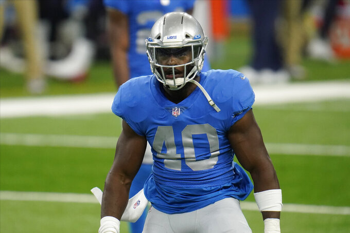 FILE - In this Nov. 26, 2020, file photo, Detroit Lions middle linebacker Jarrad Davis plays against the Houston Texans during the first half of an NFL football game in Detroit. The New York Jets and former Lions linebacker Davis have agreed on a one-year deal, according to a person with direct knowledge of the move. (AP Photo/Paul Sancya, File)