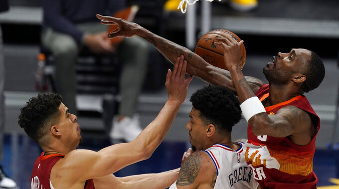 Philadelphia 76ers forward Danny Green, center, fights for control of a rebound with Denver Nuggets forwards Michael Porter Jr., left, and Will Barton in the first half of an NBA basketball game Tuesday, March 30, 2021, in Denver. (AP Photo/David Zalubowski)
