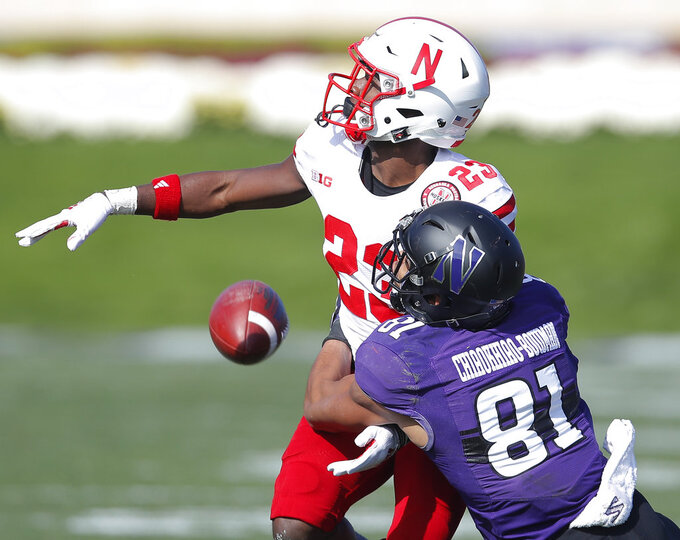 Nebraska's Dicaprio Bootle, left, breaks up a pass intended for Northwestern's Ramaud Chiaokhiao-Bowman during the second half of an NCAA college football game Saturday, Oct. 13, 2018, in Evanston, Ill. (AP Photo/Jim Young)