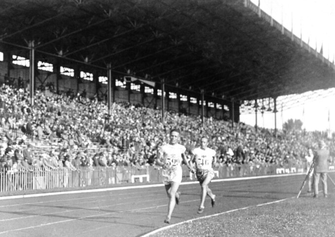 FILE - In this 1924 file photo, Vilho Ritola, of Finland, leads the field during the men's 10,000-meter race at the 1924 Olympics in Paris. Ritola won the gold medal for the event. (AP Photo/File)