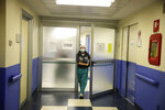 Nurse Cristina Settembrese leaves the intensive care unit after finishing a night shift, before an interview with the Associated Pressat the San Paolo hospital, in Milan, Italy, Thursday, Oct. 15, 2020. (AP Photo/Luca Bruno)
