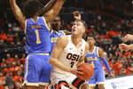 Oregon State's Tres Tinkle looks for a path to the basket past UCLA's Moses Brown during the first half of an NCAA college basketball game in Corvallis, Ore., Sunday, Jan. 13, 2019. (AP Photo/Amanda Loman)