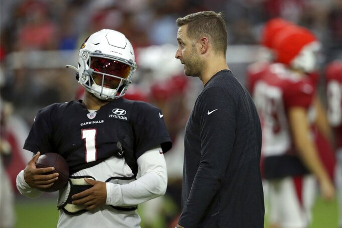 Arizona Cardinals head coach Kliff Kingsbury, right, talks with rookie quarterback Kyler Murray (1) during an NFL football training camp practice at State Farm Stadium Tuesday, Aug. 6, 2019, in Glendale, Ariz. (AP Photo/Ross D. Franklin)
