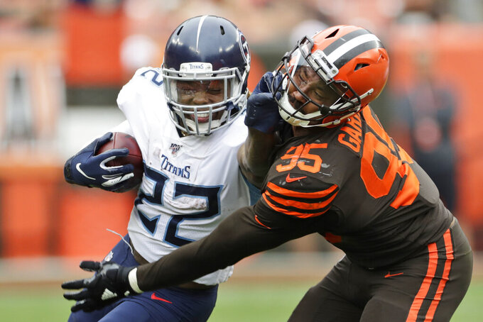 Tennessee Titans running back Derrick Henry (22) called for a face mask penalty against Cleveland Browns defensive end Myles Garrett (95) during the second half in an NFL football game Sunday, Sept. 8, 2019, in Cleveland. (AP Photo/Ron Schwane)