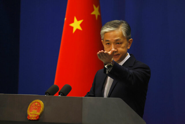 Foreign Ministry spokesperson Wang Wenbin gestures for questions during the daily briefing in Beijing on Thursday, July 23, 2020. China said