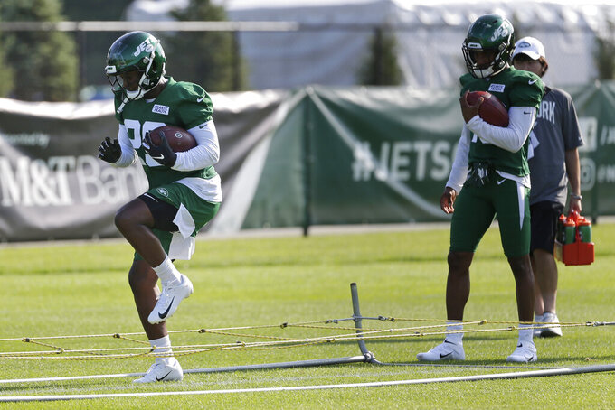 New York Jets running back Bilal Powell participates in a practice at the NFL football team's training camp in Florham Park, N.J., Friday, July 26, 2019. (AP Photo/Seth Wenig)