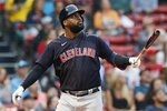 Cleveland Indians' Franmil Reyes watches his two-run double during the ninth inning of a baseball game against the Boston Red Sox, Sunday, Sept. 5, 2021, in Boston. (AP Photo/Michael Dwyer)